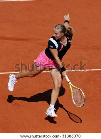 PARIS - JUNE 1: Svetlana Kuznetsova of Russia in action at French Open, Roland Garros on June 1, 2009 in Paris, France. - stock photo