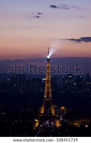 PARIS - JUNE 15: The Eiffel Tower at night, on June 15, 2012 in Paris, France. The tower has become the most prominent symbol of both Paris and France. It's the most-visited paid monument in the world - stock photo