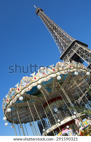 PARIS - JUNE 23: The Eiffel Tower with blue sky on June 23, 2015 in Paris. The Eiffel tower is the most visited monument of France with about 6 million visitors every year.