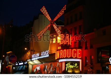 PARIS - JUNE 15: The Moulin Rouge at night, on June 15, 2012 in Paris, France. It's a famous cabaret in Pigale and is best known as the spiritual birthplace of the modern form of the can-can dance - stock photo