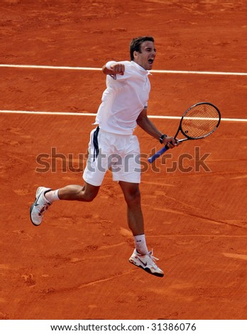 PARIS - JUNE 1: Tommy Robredo of Spain celebrates after winning a match at French Open, Roland Garros on June 1, 2009 in Paris, France. - stock photo