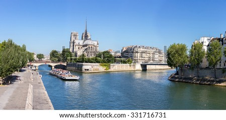 PARIS - JUNE 21: Unidentified tourists riding cruise in River Seine at Cathedral Notre Dame. Notre-Dame, is a historic Catholic cathedral, now one of Paris's primary tourist destinations. - stock photo