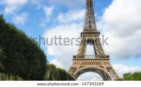 Paris, La Tour Eiffel. Beautiful view of famous tower from Champs de Mars. - stock photo