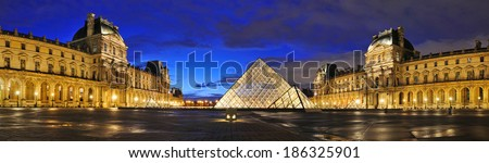PARIS - MAR 2: External night panoramic view of the Louvre Museum (Musee du Louvre) on March 2, 2014 in Paris, France. Panoramic picture done from six pictures. - stock photo