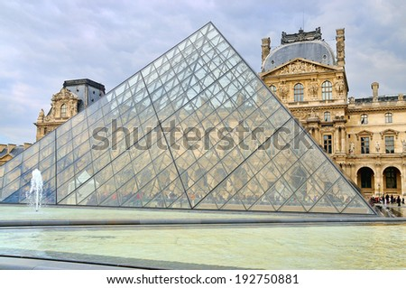 PARIS - MAR 1: External view of the Louvre Museum (Musee du Louvre) on March 1, 2014 in Paris, France. - stock photo