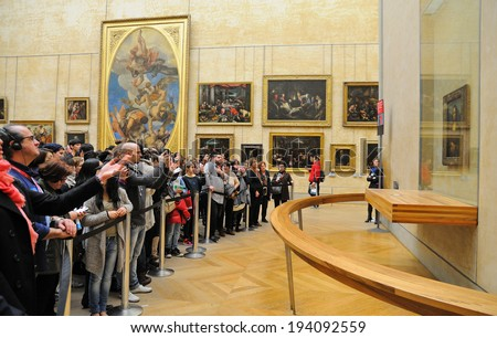 PARIS - MAR 1: People waiting on queue to see the Mona Lisa painting at the Louvre Museum (Musee du Louvre) on March 1, 2014 in Paris, France. - stock photo