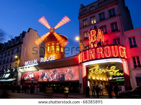 PARIS - MAR 3: The Moulin Rouge by night, on March 3, 2010 in Paris, France. Moulin Rouge is a famous cabaret built in 1889 and is located in the Paris red-light district of Pigalle. - stock photo