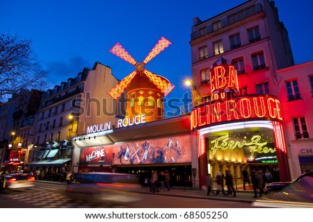 PARIS - MAR 3: The Moulin Rouge by night, on March 3, 2010 in Paris, France. Moulin Rouge is a famous cabaret built in 1889 and is located in the Paris red-light district of Pigalle - stock photo