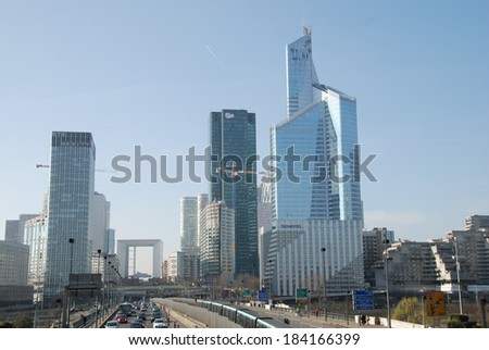 PARIS - MARCH 8, 2014: A subway leaves La Defense business district. La Defense is the largest business district in Europe with the headquarters of 15 of the top 50 companies in the world.