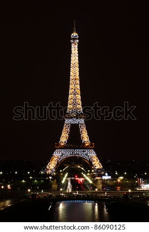 PARIS - MARCH 12: Eiffel Tower at night on March 12, 2011. The Eiffel tower is the most visited monument of France.