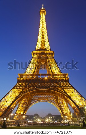 PARIS - MARCH 24: Eiffel Tower brightly illuminated at dusk on March 24, 2011 in Paris. The Eiffel tower is the tallest monument in Paris and the most-visited in France. - stock photo