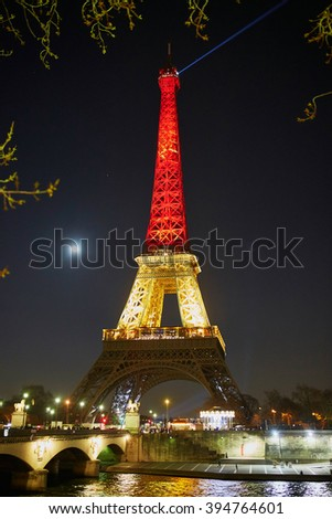 PARIS - MARCH 22: Eiffel tower illuminated with colors of the Belgian national flag on the day of terrorist attck on March 22, 2016 in Brussels