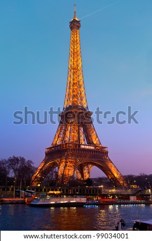 PARIS - MARCH 31: Eiffel Tower in festive illumination to Birthday (it is open on March 31 1889), view from the Seine quay, March 31, 2012 in Paris, France. - stock photo