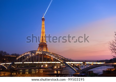 PARIS - MARCH 31: Eiffel Tower in festive illumination to Birthday (it is open on March 31 1889), view from the bridge Passerelle Debilly, March 31, 2012 in Paris, France. - stock photo