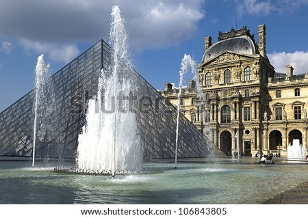 PARIS - MARCH 15 : Glass Pyramid and the fountain at the Louvre Museum on March 15, 2010 in PARIS .The museum was inaugurated in 1739 - stock photo