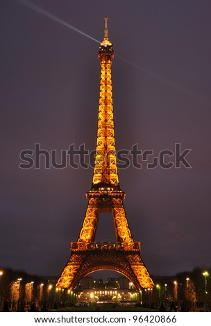 PARIS - MARCH 31: Light Performance Show on March 31, 2012 in Paris, France. The Eiffel tower stands 324 metres (1,063 ft) tall. Monument was built in 1889, attendance is over 7 millions people. - stock photo