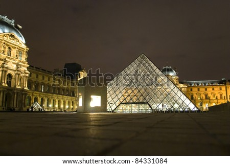 PARIS - MARCH 20: Louvre Pyramid shines at night during the winter March 20, 2008 in Paris. Louvre is the biggest Museum in Paris displaying over 60,000 square meters of exhibition space.