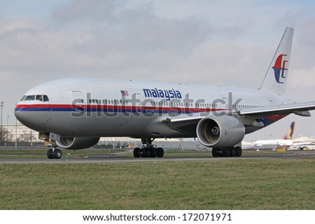 PARIS - MARCH 29: Malaysia Airline Boeing 777 taxis to take off on March 29, 2010 in Paris, France. Malaysia Airlines (MAS) operates flights from its home base, Kuala Lumpur International Airport. - stock photo