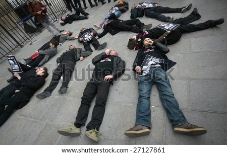 PARIS - MARCH 22: Members of the Act Up organisation lay down by Notre-Dame Cathedral to protest against Pope Benedict XVI's remarks on condoms and abortion on March 22, 2009 in Paris, France