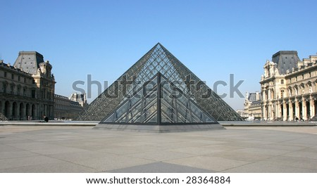 PARIS - MARCH 14: Museum du Louvre and the Pyramid March 14, 2006 in Paris France - stock photo