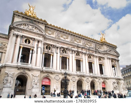 PARIS - MARCH 8 : Unidentified people sitting in front of the Opera, on March 8, 2008, in Paris, France.  - stock photo