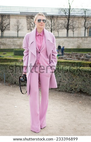 PARIS - MARS 5, 2013: Stylish European woman with pink dress in the Tuileries Garden. Paris Fashion Week: Ready to Wear 2013/2014 is held from February 26 to March 6, 2013. - stock photo