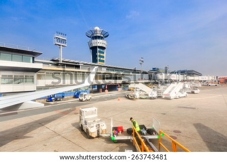 PARIS - MARS 18 : unloading of baggage in airport of Orly on Mars 18, 2015 in Paris, France. Paris Orly Airport is an international airport located partially in Orly, south of Paris - stock photo