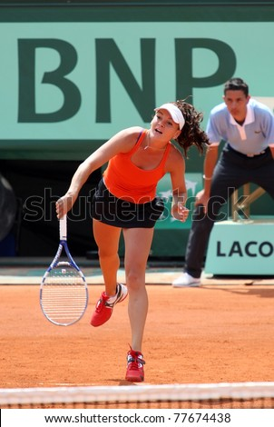 PARIS - MAY 21: Agnieszka RADWANSKA of Poland plays the exhibition match at French Open, Roland Garros on May 21, 2011 in Paris, France. - stock photo
