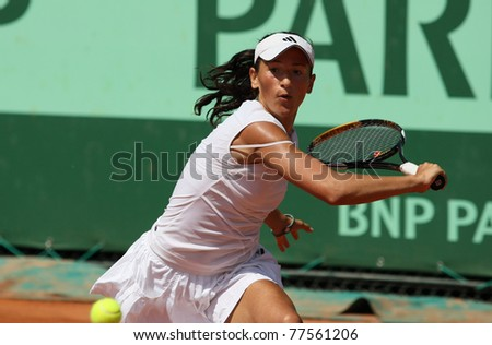 PARIS - MAY 19: Alexandra Cadantu of Roumania plays the 2nd round qualification match at French Open, Roland Garros on May 19, 2011 in Paris, France. - stock photo