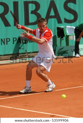 PARIS - MAY 21: Alexandre SIDORENKO of France in action at French Open, Roland Garros qualification 3rd round match on May 21, 2010 in Paris, France. - stock photo