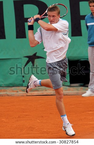 PARIS - MAY 23: Alexandre SIDORENKO of France in action during the match at French Open, Roland Garros on May 23, 2009 in Paris, France. - stock photo