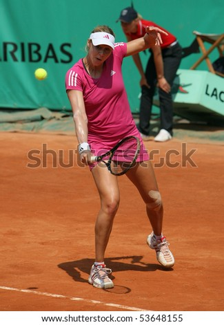 PARIS - MAY 22: Alicia MOLIK of Australia plays the exhibition match at French Open, Roland Garros on May 22, 2010 in Paris, France. - stock photo