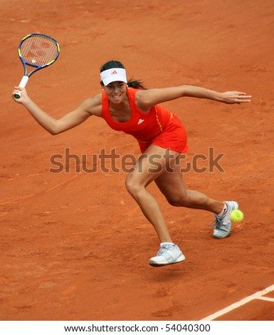 PARIS - MAY 27: Ana IVANOVIC of Serbia in action during the 2nd round match at French Open, Roland Garros on May 27, 2010 in Paris, France. - stock photo