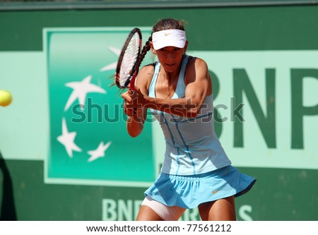 PARIS - MAY 19: Anastasia Pivovarova of Russia plays the 2nd round qualification match at French Open, Roland Garros on May 19, 2011 in Paris, France. - stock photo