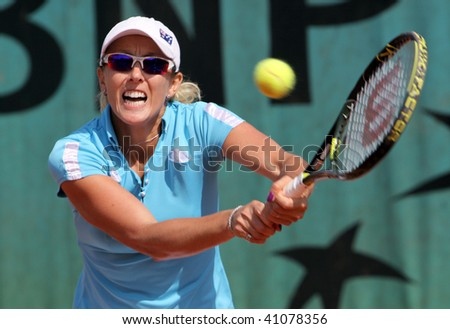 PARIS - MAY 20: Anastasia RODIONOVA of Australia in action at French Open, Roland Garros on May 20, 2009 in Paris, France. - stock photo