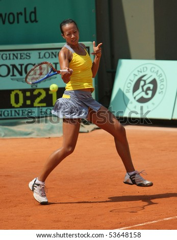 PARIS - MAY 22: Anne KEOTHAVONG of Great Britain plays the exhibition match at French Open, Roland Garros on May 22, 2010 in Paris, France. - stock photo