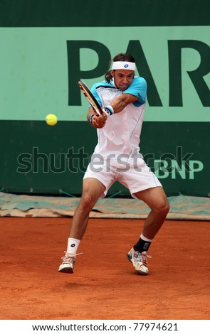 PARIS - MAY 20: Antonio Veic of Croatia plays the 3rd round qualification match  at French Open, Roland Garros on May 20, 2011 in Paris, France. - stock photo