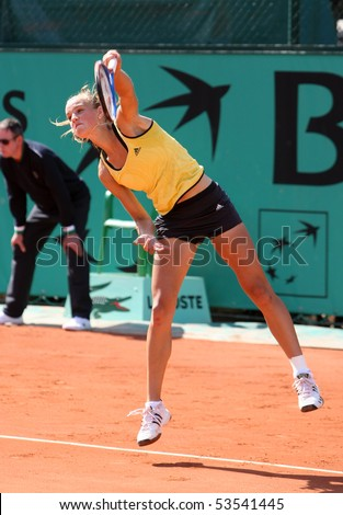 PARIS - MAY 20: Arantxa RUS of Netherlands serves at French Open, Roland Garros qualification 2nd round match on May 20, 2010 in Paris, France. - stock photo