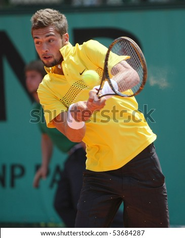 PARIS - MAY 21: Benoit PAIRE of France in action at French Open, Roland Garros qualification 3rd round match on May 21, 2010 in Paris, France. - stock photo