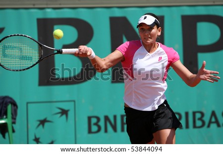 PARIS - MAY 20: Chanelle SCHEEPERS of South Africa in action during the 2nd round qualification match at French Open, Roland Garros on May 20, 2010 in Paris, France. - stock photo