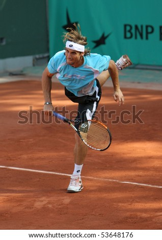 PARIS - MAY 22: David FERRER of Spain during his practice at French Open, Roland Garros on May 22, 2010 in Paris, France. - stock photo