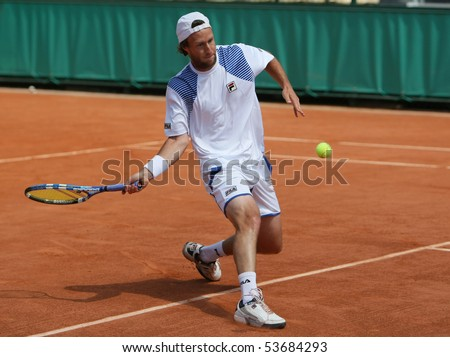 PARIS - MAY 21: Dieter KINDLMANN of Germany in action at French Open, Roland Garros qualification 3rd round match on May 21, 2010 in Paris, France. - stock photo