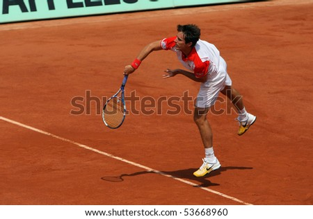 PARIS - MAY 22: Edouard ROGER-VASSELIN of France plays an exhibition match at French Open, Roland Garros on May 22, 2010 in Paris, France. - stock photo