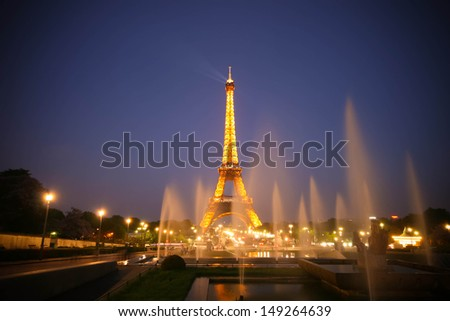 PARIS - MAY 20: Eiffel tower light show on May 20, 2010 in Paris, France. The Eiffel tower stands 324 metres (1,063 ft) tall. Monument was built in 1889, attendance is over 7 millions people. - stock photo