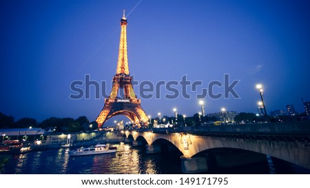 PARIS - MAY 20: Eiffel Tower on May 22, 2010 in Paris. The Eiffel tower is the most visited monument of France. - stock photo