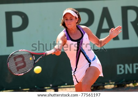 PARIS - MAY 19: Eirini Georgatou of Greece plays the 2nd round qualification match at French Open, Roland Garros on May 19, 2011 in Paris, France. - stock photo