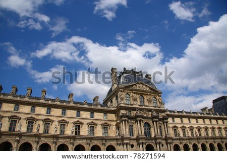 PARIS - MAY 8: Facade of Louvre. It is one of the largest and the most visited art museum in the world. A central landmark of Paris. France. May 8, 2011. - stock photo