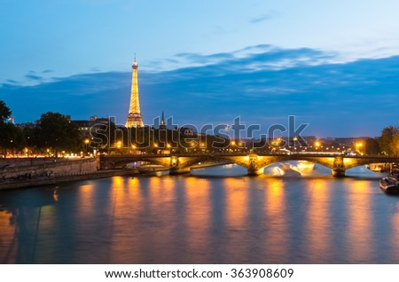 PARIS - MAY 25 2015: Famous Eiffel Tower and bridge Pont des Invalides in Paris, France. The Pont des Invalides is the lowest bridge traversing the Seine in Paris.