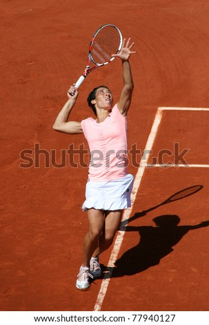 PARIS - MAY 23: Francesca Schiavone of Italy plays the 1st round match at French Open, Roland Garros on May 23, 2011 in Paris, France. - stock photo