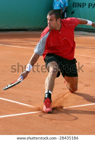 PARIS - MAY 20: Germany's professional tennis player Benedikt Dorsch during the match at French Open, Roland Garros, May 20, 2008 in Paris, France. - stock photo